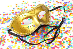 mask-carnival-confetti-golden-ribbons-background-39076906